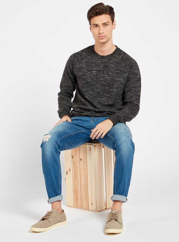 بنطلون جينز طويل ممزّق بزر إغلاق وجيوب