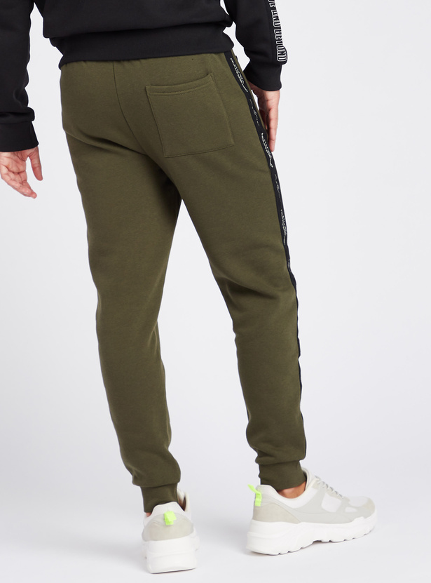 Slim Fit Full Length Mid-Rise Jog Pants with Pockets and Tape Detail