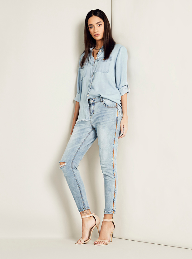 Skinny Fit Distressed Mid-Rise Jeans with Pockets and Side Piping